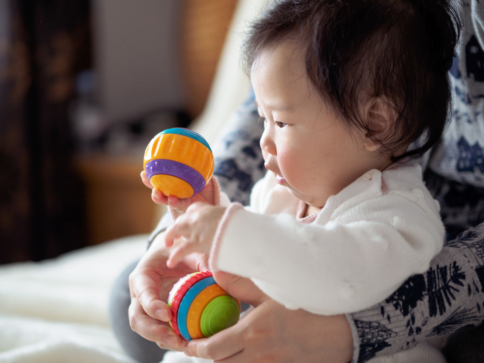 Baby with toy ball