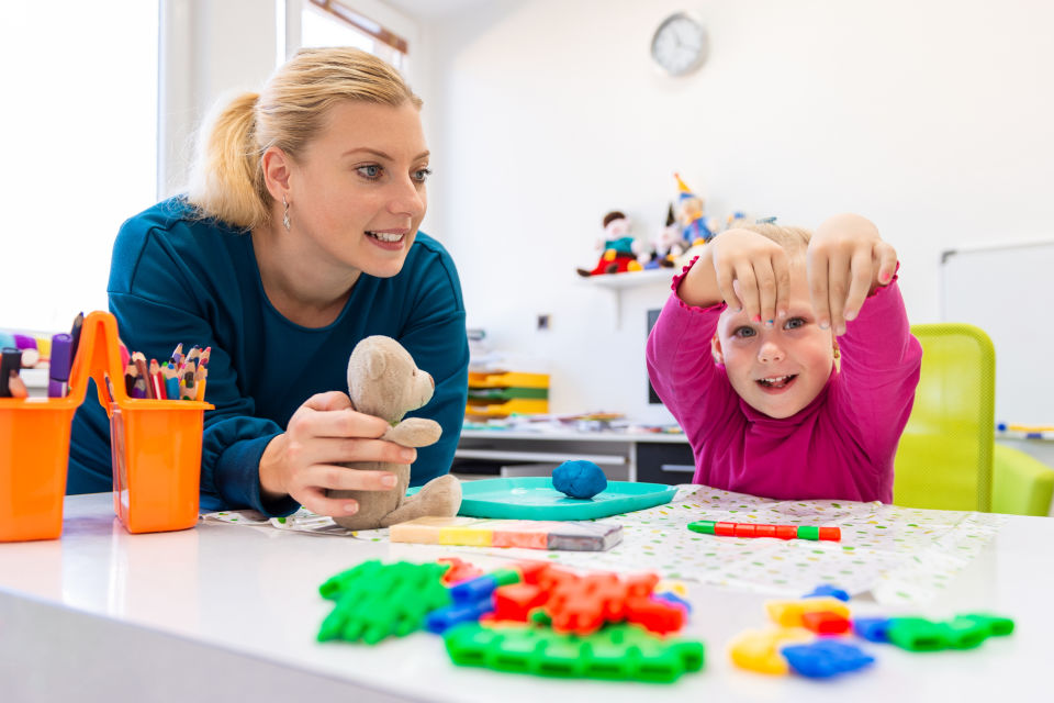 Teacher doing activities with girl-Special Needs