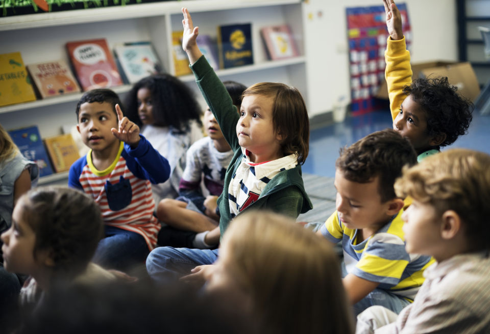 Kids Particpating in class raising hands