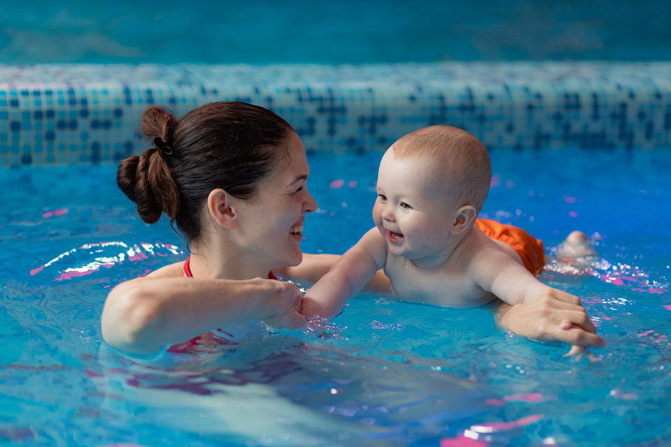 Mother and baby in pool