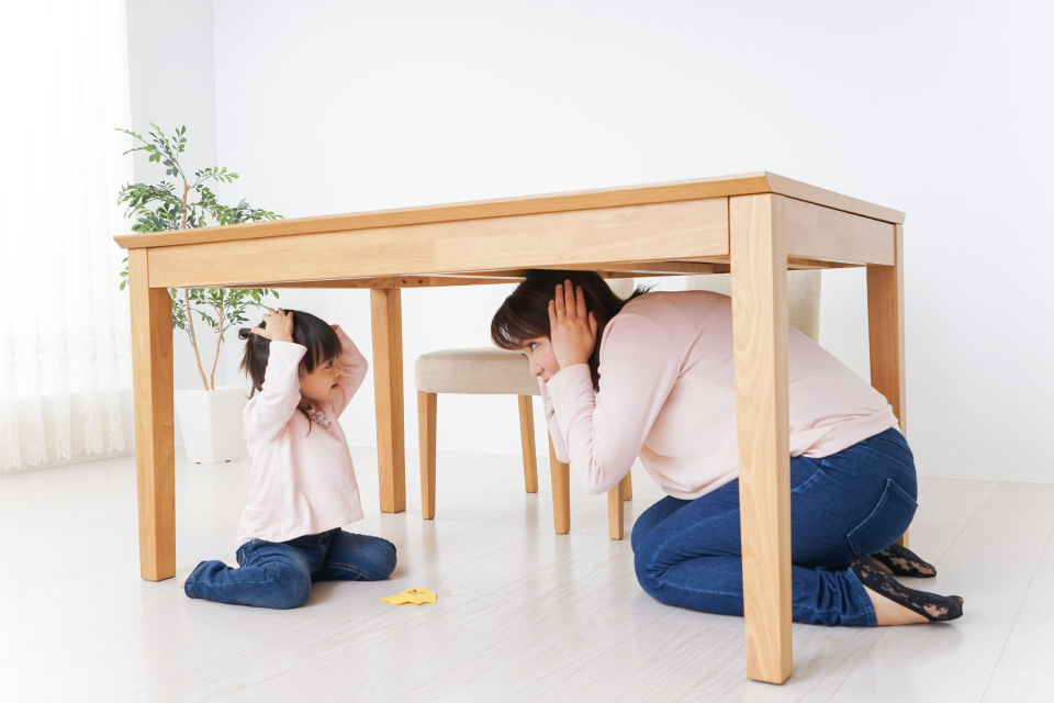 Mother and daughter practicing earthquake drills