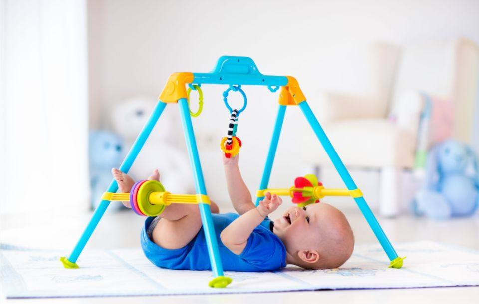 Baby playing with baby rocker toys