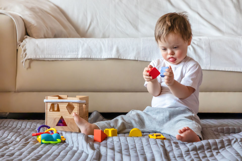 Boy with special needs playing with blocks