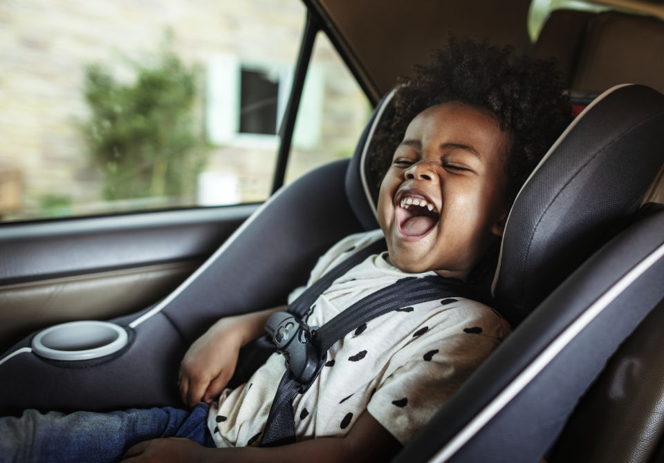 Toddler-Boy laughing in car seat
