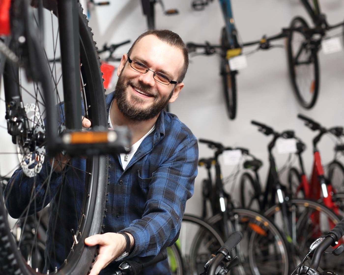 Bloke in a bike shop, surrounded by bikes