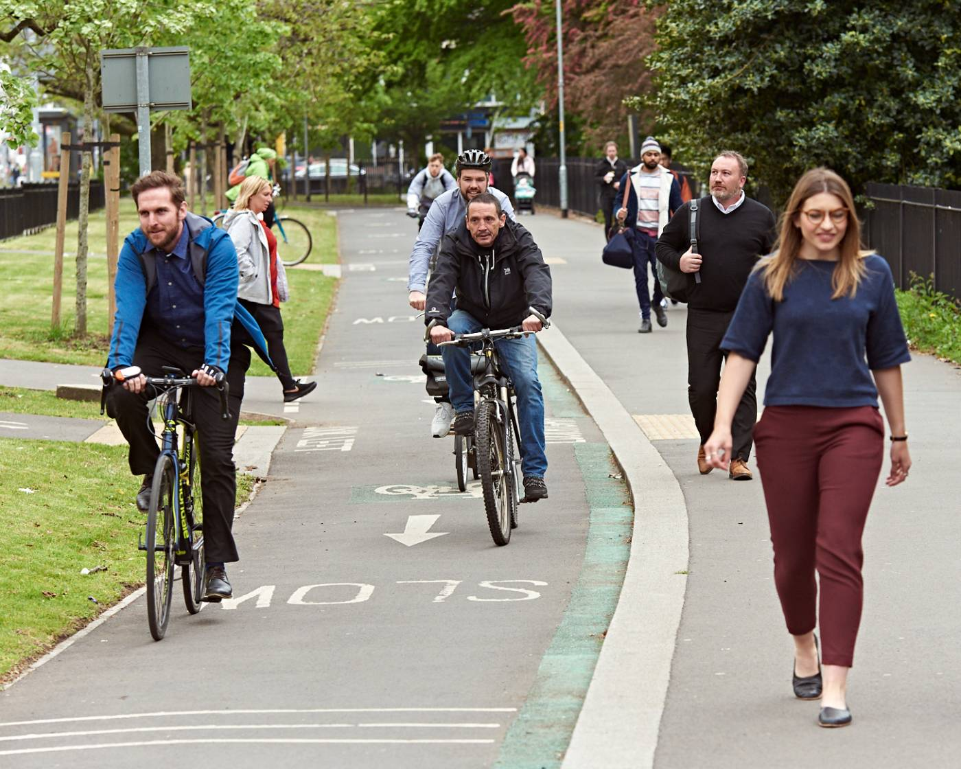 People strolling on pavement and cycling on a segregated cycle lane