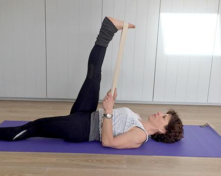 Fenella shows supta padanghustana yoga pose with free leg straightened