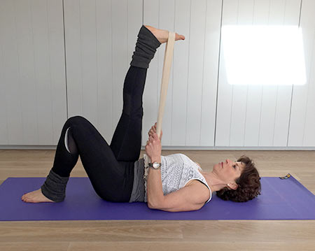 Fenella shows supta padanghustana yoga pose with free leg bent