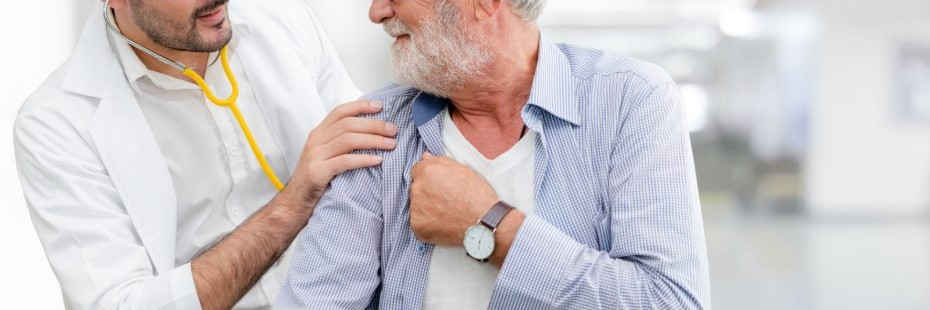Young male doctor with older male patient