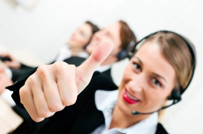 Call center agent giving thumbs up