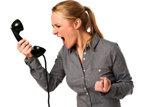 Woman screaming angerly into phone