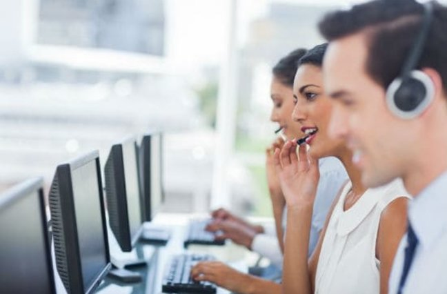 Call center agents in call center busily working