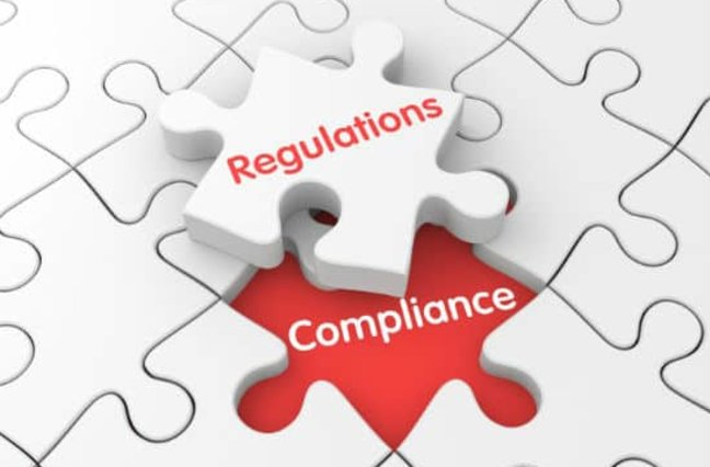 Puzzle pieces read Regulations and Compliance