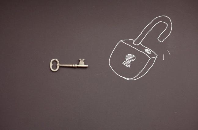 skeleton key next to chalkboard drawing of opened padlock