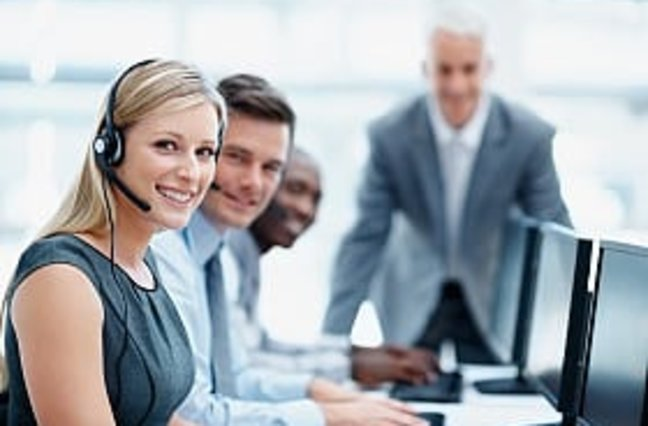 Young, motivated business team with manager at a call center