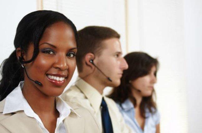 Call center agent smiling into camera
