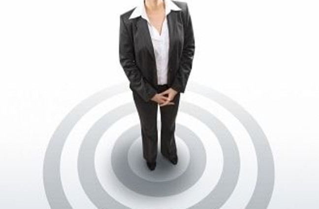 Business woman standing on bullseye