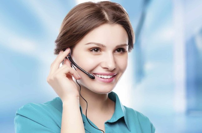 Happy smiling call center agent