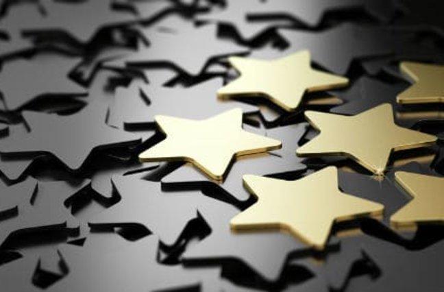 6 shiny gold stars on top of black stars