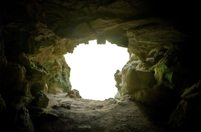 looking out of a cave