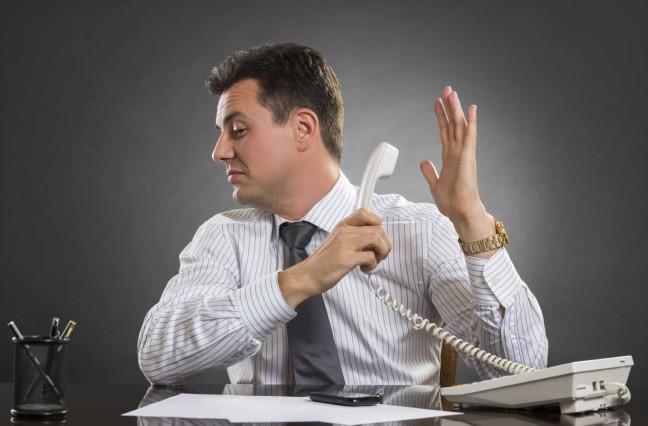 businessman avoiding answering phone
