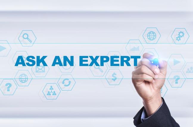 Businessman drawing on virtual screen. ask an expert concept.