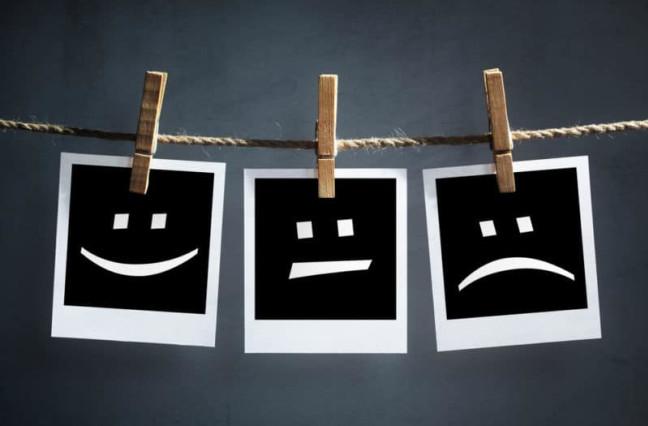 Polaroid photos showing happy face, neutral face, sad face