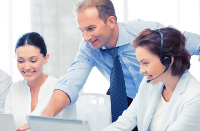 Call center manager giving feedback to agents