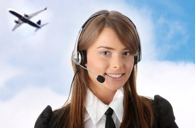 Smiling call center agent with clouds and airplane in background