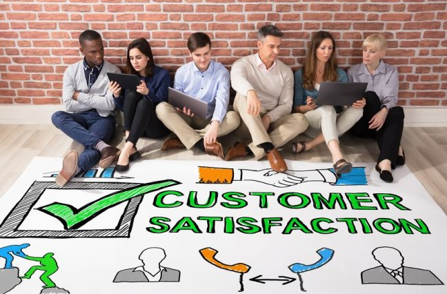 People looking at customer satisfaction survey concept