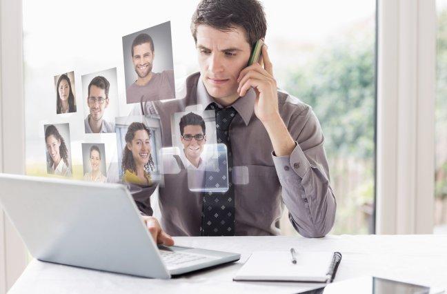 man at desk on phone
