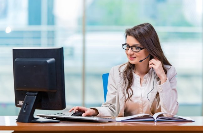 Woman at desk in a call center