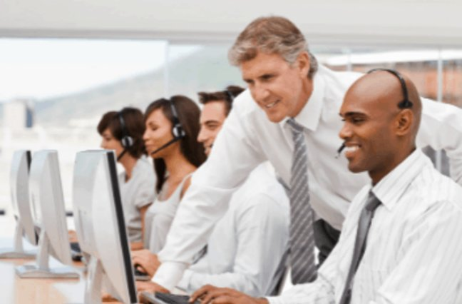 Call center manager coaching an agent