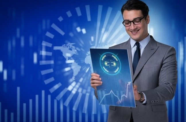 Happy businessman reviewing analytics on tablet