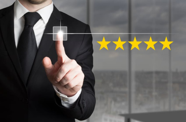 Customer Experience - businessman virtually rating 5 gold stars