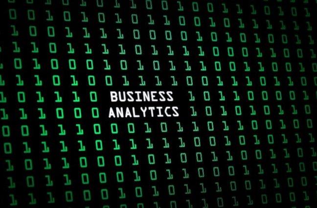 """Business analytics"" text overlay on green code"