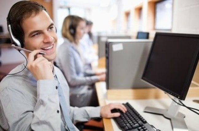 Man on phone working at a call center.