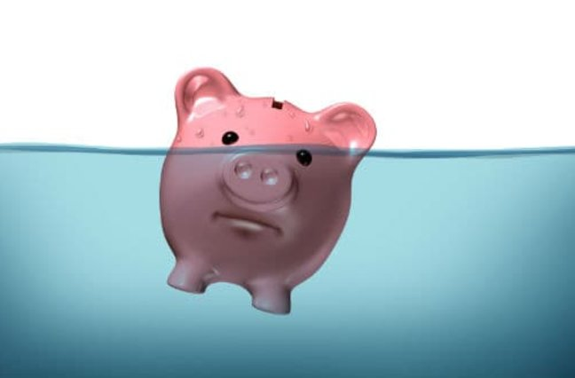 Piggy bank sinking into water