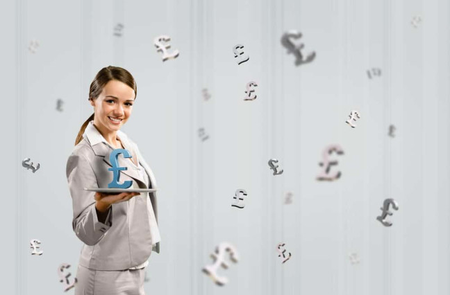 attractive business woman holding a tablet with british pound, financial concept