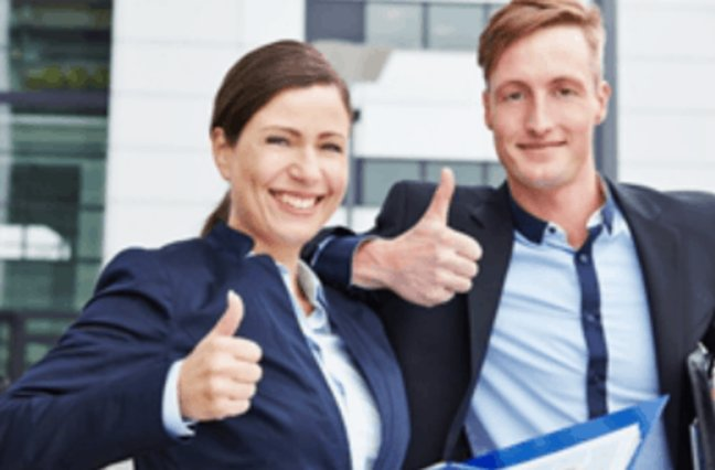 Business man and woman smiling giving thumbs up