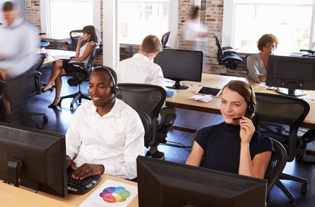 Happy busy call center agents