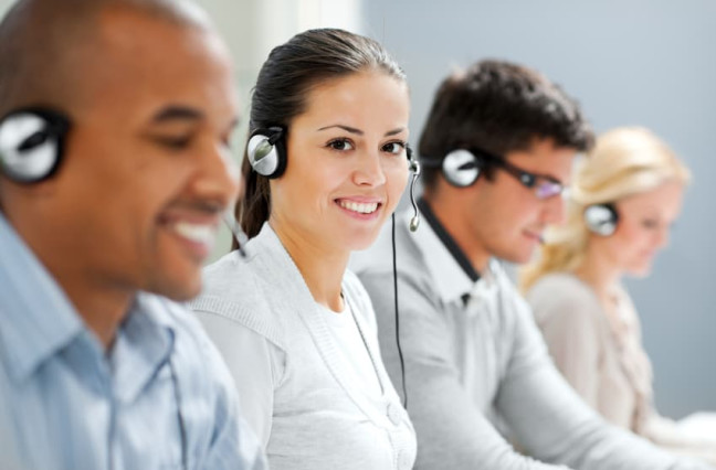 Call center with several smiling agents