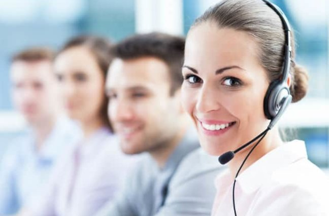 Smiling woman with headset on.