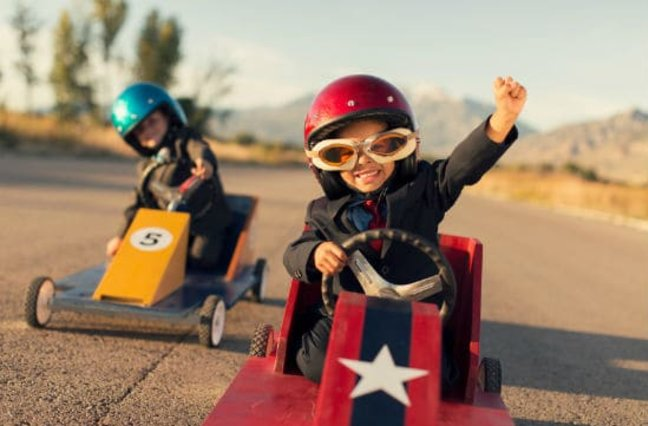 Two children in go-karts
