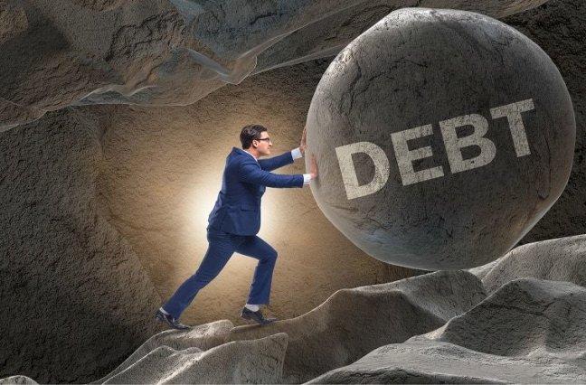 """Man pushes boulder uphill, labelled """"debt"""""""