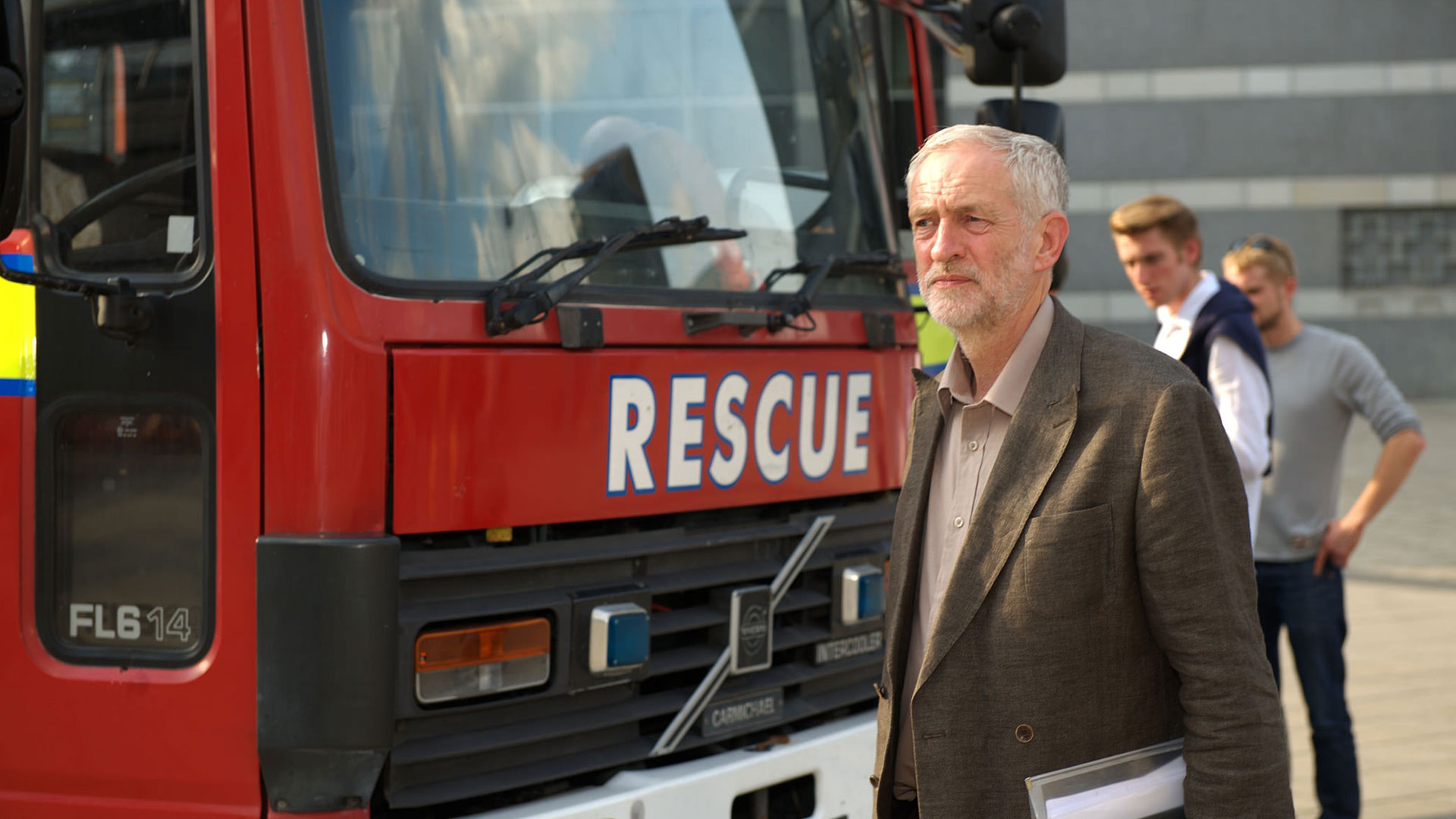 Photo of Jeremy Corbyn stood next to a fire engine with 'Rescue' on the front