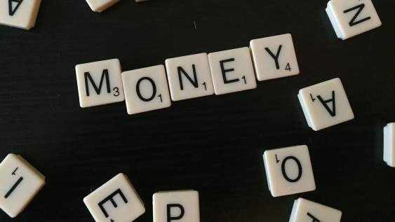 The word 'Money' spelled out in scrabble.
