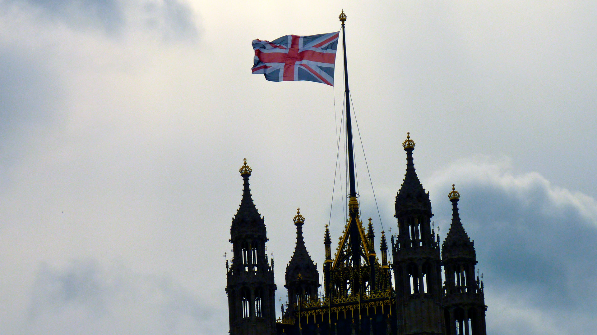 The Union Jack flying atop the Victoria Tower of the UK Houses of Parliament.