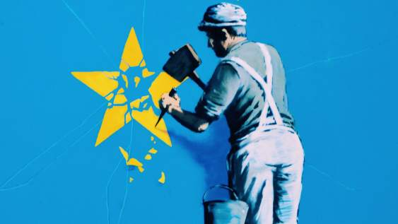 Banksy Brexit mural showing a man chiselling a star from the EU flag