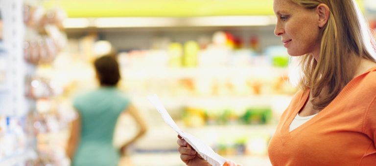 Pregnant woman is grocery shopping